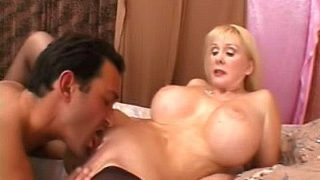 Mature Honey Displays Off Her Hefty Boobs
